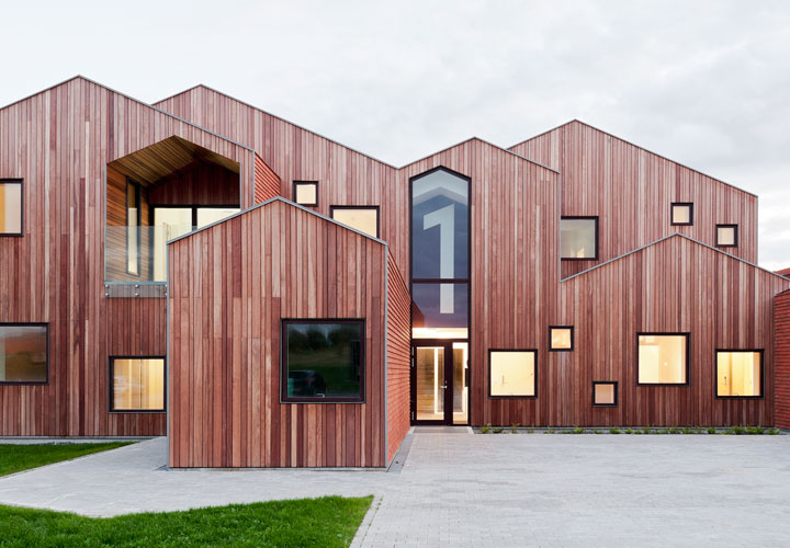 Children's Home of the Future building by CEBRA Architecture. Wood cladded facades create homely environment.
