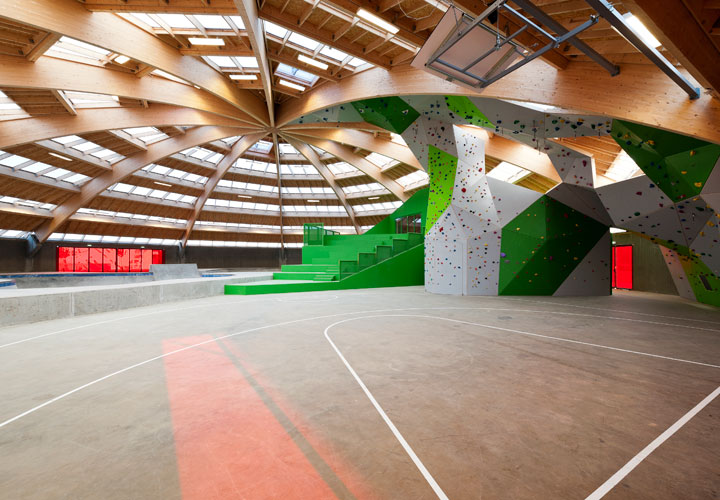 Inside StreetDome - wood architecture - green staircase - a project by CEBRA Architecuture - Denmark