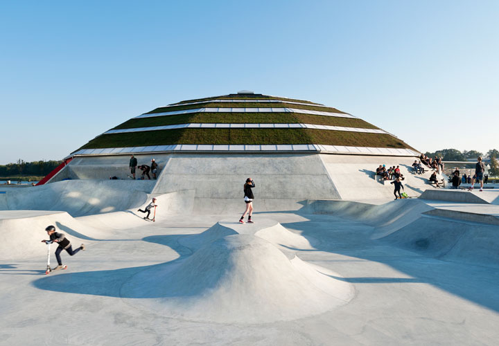 People riding Scooters at StreetDome, a project by CEBRA Architecuture - Denmark