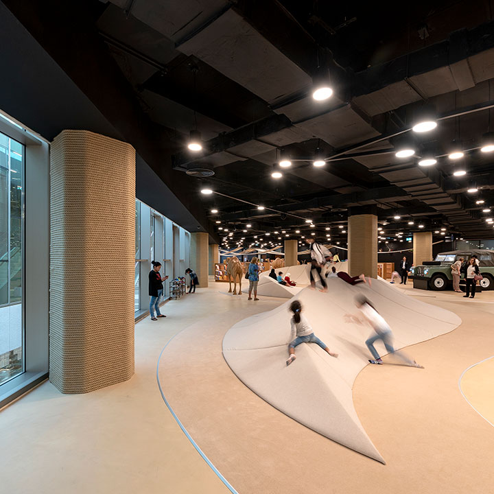 Children climbing artificial sand dunes at the children's library in abu dhabi