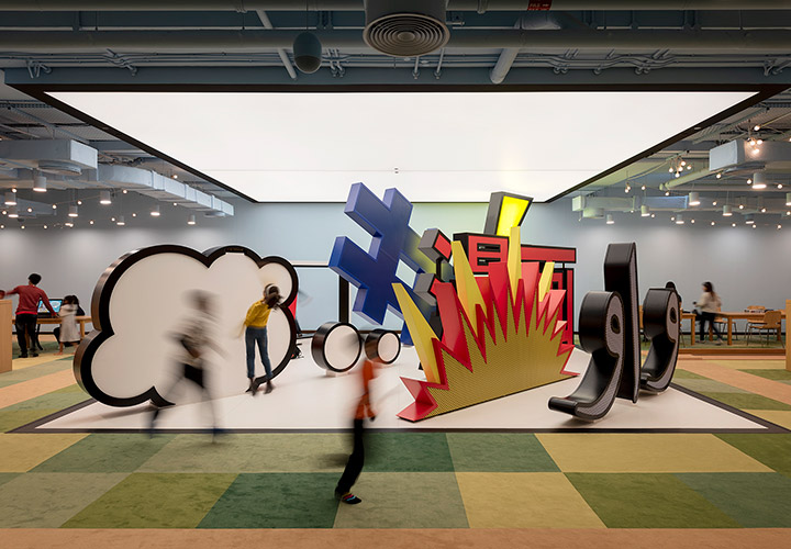 3D cartoon and cultural symbols at the children's library in abu dhabi. A speech bubble, hashtag, explosion