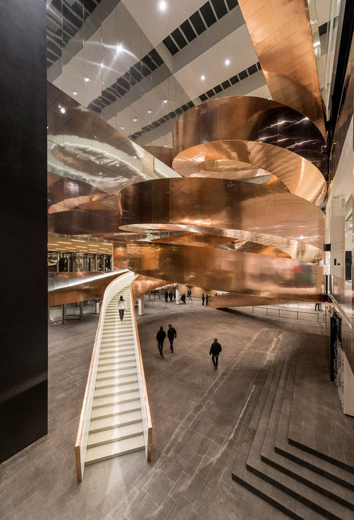 Helix staircase with copper cladding at the Experimentarium building by CEBRA Architecture - a science museum in Copenhagen.