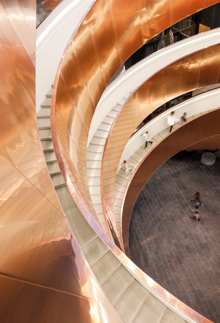 Looking down at the helix staircase at the Experimentarium building by CEBRA Architecture - a science museum in Copenhagen.