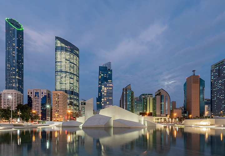 Al Musallah prayer hall in Abu Dhabi by CEBRA Architecture reflected at the water feature of the Qasr Al Hosn site.
