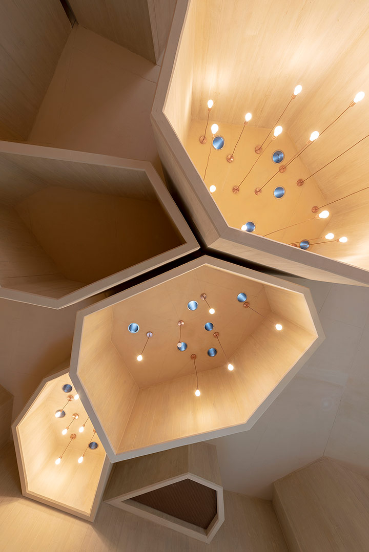 Al Musallah prayer hall in Abu Dhabi designed by CEBRA Architecture. A suspended landscape functions as skylights.