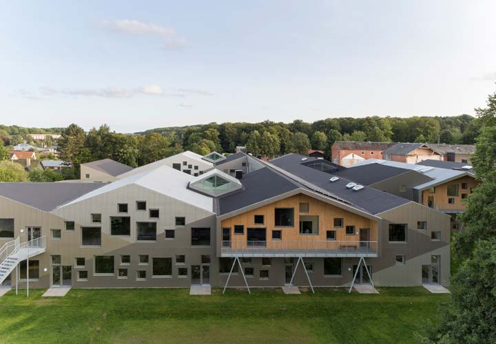 The roof of Skovbakke School seen from above. Skylights in between the pitched roof.
