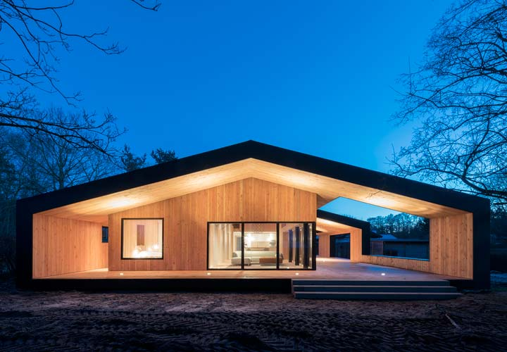 Exterior nighttime view of Treldehuset | CEBRA architecture