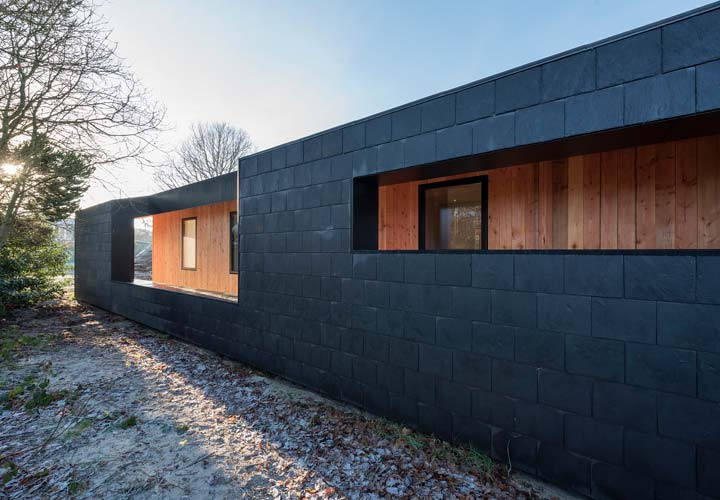 Dark slate covered Treldehuset | CEBRA architecture