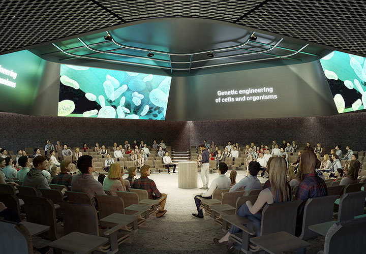 The Campfire auditorium is a theatre-in-the-round hexagonal space with surrounding digital screens