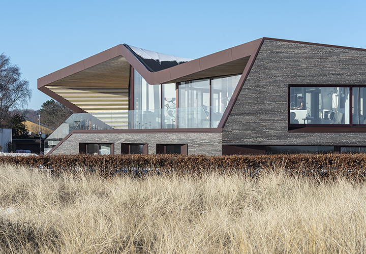 the seaside villa is located only a stone's throw from a popular beach