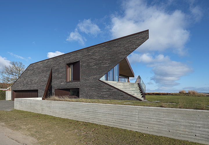 the east and west facades consist of a unique colour-mix of classic Danish Kolumba bricks, accompanied by dark red-brown aluminium and steel details