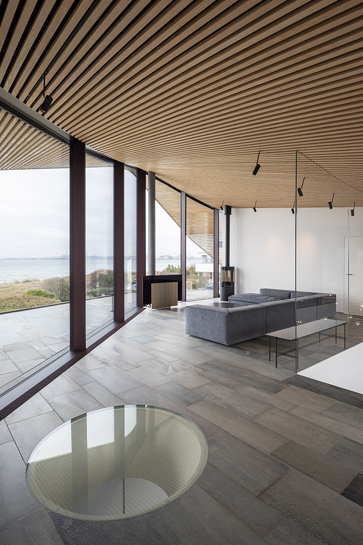 view from the living room over the Aarhus Bay through the floor-to-ceiling glass facade
