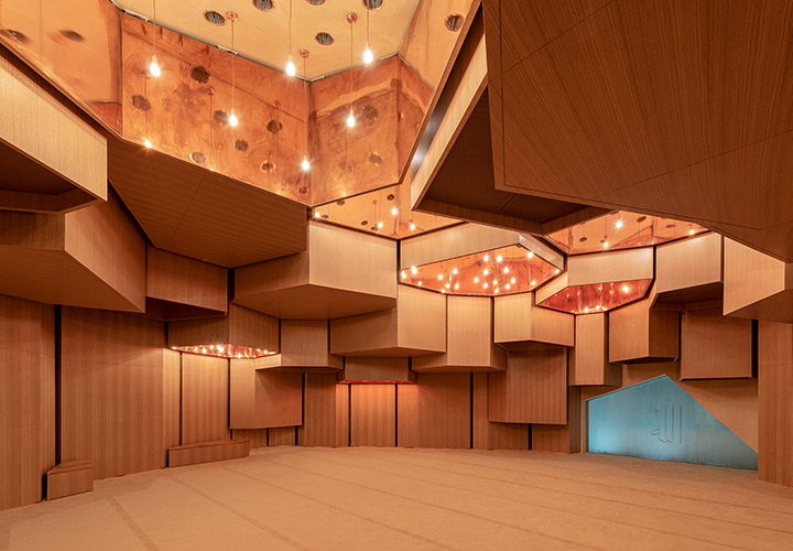 Inside Al Musallah prayer hall in Abu Dhabi designed by CEBRA Architecture. Copper clads the walls and the ceilings.
